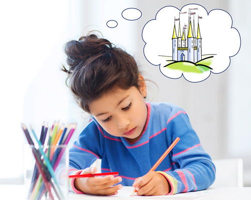 child drawing and imagining