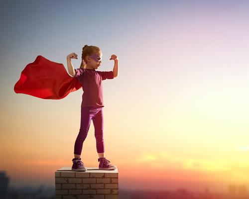 child superhero on chimney top